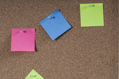 Cork board with colored post notes Royalty Free Stock Images