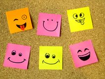 Cork board with colorful post its representing various emoticons with various emotions communication concept. Photo stock photos