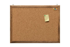 Cork board with empty post-it note and pushpins Royalty Free Stock Photos