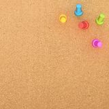 Cork board with five pins in the corner Royalty Free Stock Image