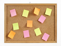 Cork board with hanger and bulletins in different color. Royalty Free Stock Photography
