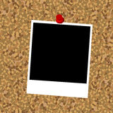 Cork board with instant photo frame Stock Images