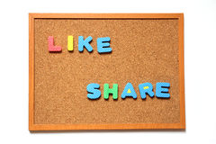 Cork board with like and share wording Royalty Free Stock Photo