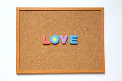 Cork board with love wording on white background Stock Images