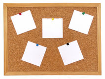 Cork board with notes. Isolated over white background Stock Images
