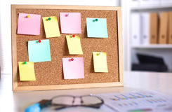 Cork board with notes, clipping path included Stock Image
