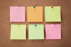 Cork board with notes and pins Royalty Free Stock Image