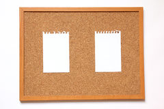 Cork board with paper note on white background Royalty Free Stock Photos
