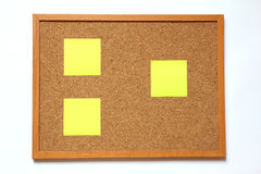 Cork board with paper note on white background Stock Images
