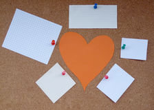Cork board papers. Heart of the paper around the paper notes Stock Photos