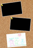Cork board with photos and family. Two photos and child family drawing on corkboard Royalty Free Stock Photos