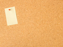 Cork board pinned note. File Stock Photo