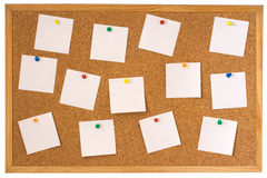 Cork board with pinned notes. Cork board with pinned white notes isolated on white background Royalty Free Stock Images
