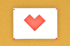 Cork board with red heart on paper Royalty Free Stock Image