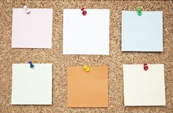 Cork board with reminder notes Stock Image