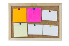 Cork board with several colorful blank notes with pins Royalty Free Stock Image