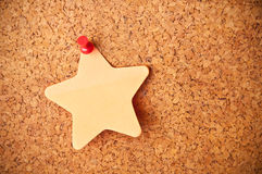 Cork board with star post-it. Close up cork board with star shaped post-it Stock Photos