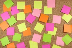 Cork board with sticky note. Cork board with colored sticky note stock images