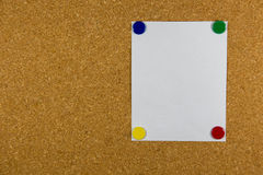 Cork board with sticky note pinned. Paper on cork board with sticky note pinned Royalty Free Stock Photography