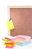 Cork board with sticky notes and pads Stock Images