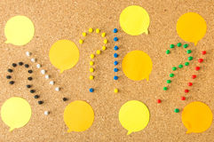 Cork board three question exclamation marks and speech bubbles Stock Photo
