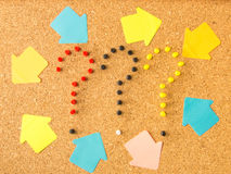 Cork board three question marks and arrows. Cork board three question marks and random arrows Royalty Free Stock Photo