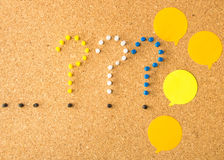 Cork board three question marks points and speech bubbles. Cork board three question marks points and random speech bubbles Royalty Free Stock Photography