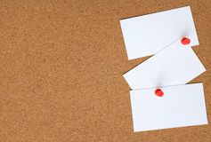 Cork board with three white cards pinned to it Stock Photography