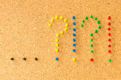 Cork board two question marks points Royalty Free Stock Photography