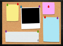 Cork board with various notes and Picture frame Stock Photo