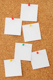 Cork board with white notes Royalty Free Stock Images