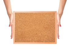 Cork-board in woman hands isolated on white Royalty Free Stock Images