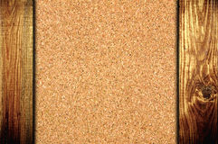 Cork board at wooden panel wall background Royalty Free Stock Photo