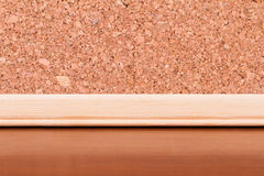 Cork Board on Wooden Table Royalty Free Stock Photography