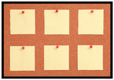 Cork board with yellow note and red pin Stock Image