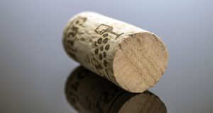 Cork of bottle of wine on black background. Conceptual image royalty free stock images