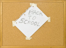 Cork bulletin board with back to school note. Royalty Free Stock Photos