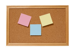 Cork Bulletin Board With Blank Notes. Cork bulletin board with colorful blank notes attached ready to add messages, notes and more.  Isolated on white background Stock Photo