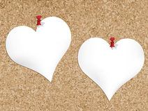 Cork bulletin board with heart shaped notepads Royalty Free Stock Photos