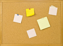 Cork bulletin board with notes. Royalty Free Stock Images