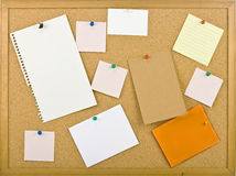 Cork bulletin board with notes. Royalty Free Stock Photography