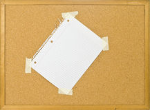 Cork bulletin board with ripped  notebook pap Stock Photography