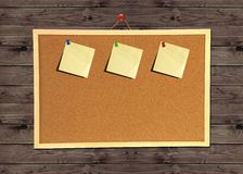 Cork bulletin board on wood wall Stock Photography