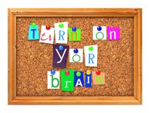 Cork Bulletin or Message Board. Turn on Your Brain Concept Letters Attached to a Cork Bulletin or Message Board with Thumbtacks. 3D Render Royalty Free Stock Photography