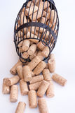 Cork cage with blank corks lies on white surface Stock Photos