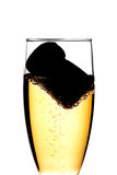 Cork and champagne. A Cork inside a cup of glass with chamagne Royalty Free Stock Images