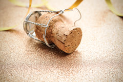 Cork from champagne bottle with streamers Stock Image