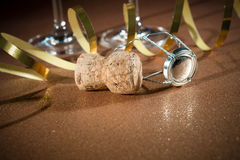 Cork from champagne bottle and two glasses Stock Images