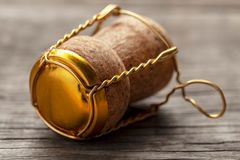 Cork from champagne or wine on the old wooden table. stock images