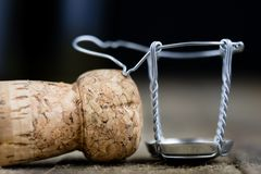 Cork from champagne on a wooden kitchen table. Good New Year's d. Rinks and great fun. Dark background Stock Photos